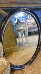 Oval Mirror in black with a little gold accent